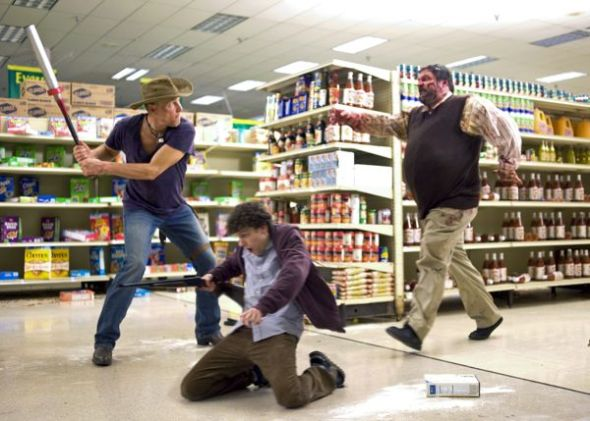 Woody Harrelson (left) and Jesse Eisenberg (center) star in Columbia Pictures' ZOMBIELAND.